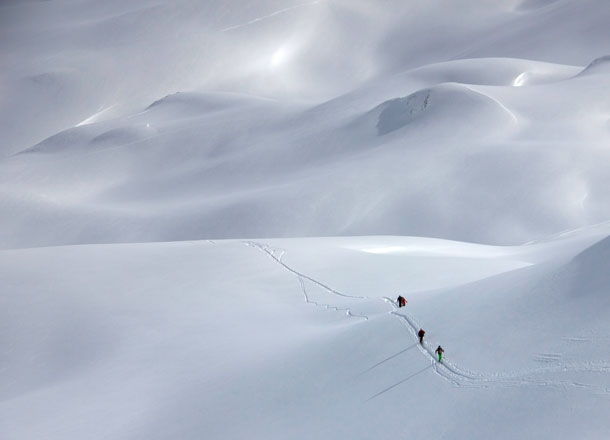 Ski touring with a guide.
